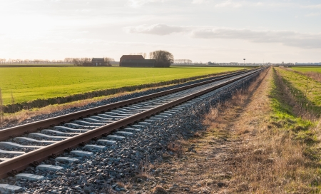 seemingly: Seemingly endless rails in a Dutch landscape. Stock Photo