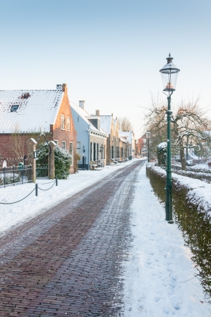 A small historic Dutch village covered with snow. Stock Photo - 17377670