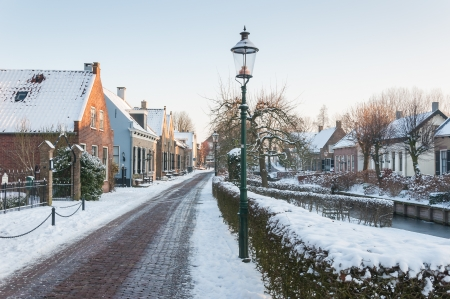 A small historic Dutch village covered with snow.