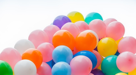 Many balloons in varied colors against a white background photo