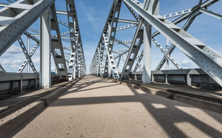 Small road between two historic truss bridges in the Netherlands. photo