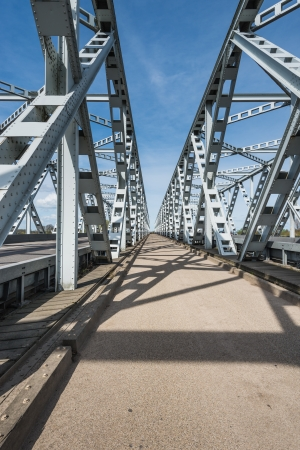 truss: Small road between two historic truss bridges in the Netherlands. Stock Photo