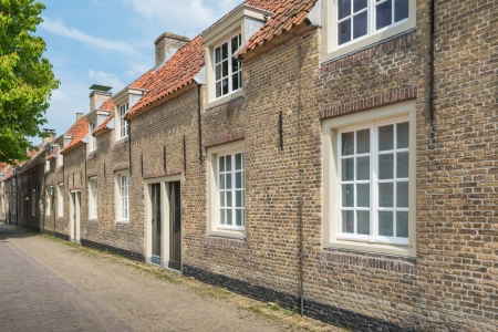 Row of ancient small houses in an historic street in the Netherlands. photo