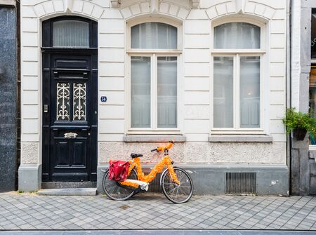 festively: Festively decorated bicycle parked against the facade of a ancient private residence.
