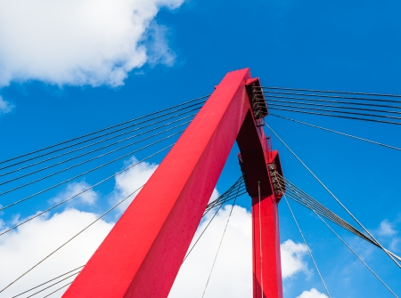 Colorful view at a part of cable stayed bridge on a sunny day in the Netherlands. Stock Photo - 23247999