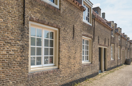 Historic street with old houses of brick masonry in the Netherlands  photo
