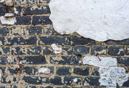 Detailed image of an old original white plastered brick wall of an old brick factory in Belgium photo