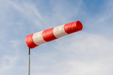 Horizontally flying windsock due to high wind. photo