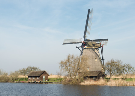 Polder windmill from the year 1740. The mills in the Dutch village of Kinderdijk were in use  for the water management of the polder. They are now on the World Heritage List of UNESCO. photo
