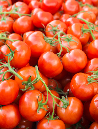Tasty ripe vine tomatoes on a stack.