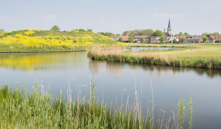 smal: Colorful Dutch landscape at the outskirts of a smal village in the early spring season  Stock Photo