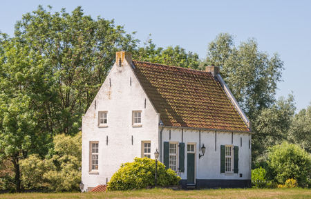 plastered: Picturesque old white plastered house in a rural area