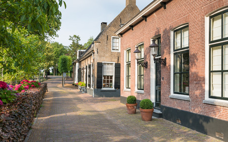 north brabant: Facades lit by the sun of the brick houses in the historic village of Drimmelen, North Brabant, Netherlands  Editorial