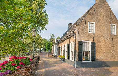 drimmelen: Facades lit by the sun of the brick houses in the historic village of Drimmelen, North Brabant, Netherlands. Editorial