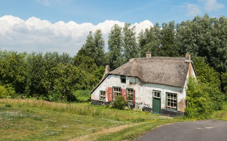 abandoned farmhouse abandoned farmhouse: Abandoned and neglected historic farmhouse down a Dutch embankment  Editorial