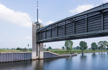 surge: This storm surge barrier is a hydraulic engineering work in the very large Dutch Delta Works project