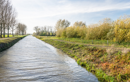 polder: Rippling water surface of a canal in a Dutch polder in autumn.