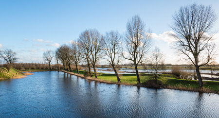 View of an picturesque  Dutch landscape in winter in low afternoon sunlight photo