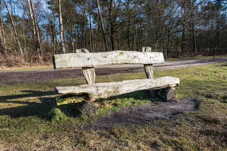 decayed: Partly decayed simple wood bench made of logs. The bank is in a Belgian nature reserve.