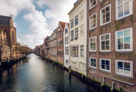 canal houses: The Church of Our Lady and a row of canal houses in the Dutch city of Dordrecht.