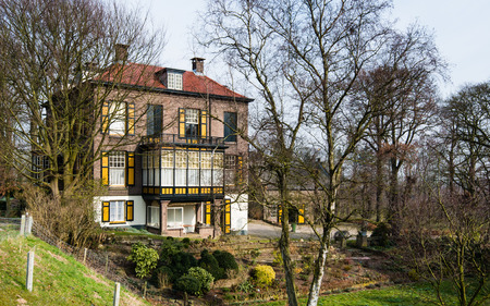 temporarily: Rear of a charming character house to a Dutch dike. The villa was built in 1911 for a brick manufacturer. Then it was temporarily used as a hall of a small village. To the right of the large building is the Carriage House. It is the end of the winter seas
