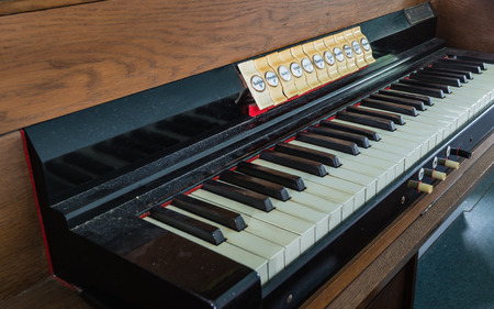 pipe organ: Closeup of the dusty keyboard of an old pipe organ in a Dutch Protestant church.