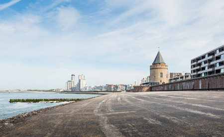 flushing: Coastline of Flushing in the Netherlands with in the foreground the historic Prison Tower now restored and in use as a restaurant. Stock Photo