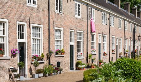 breda: Restored 16th-century houses in a row in the Beguinage in Breda, Netherlands. Stock Photo