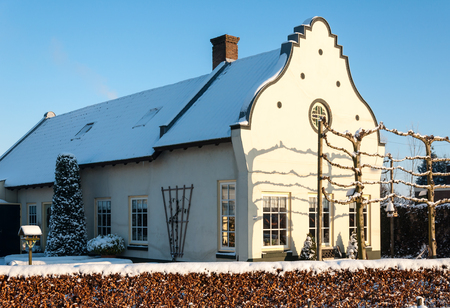 cream colored: Cream colored plastered house in the Netherlands on a sunny winter day. The property was built in 1901.