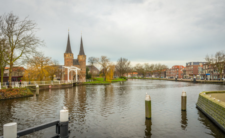 northern european: Eastern Gate (Oostpoort) in the Dutch city of Delft is an example of Brick Gothic northern European architecture. The picture was taken on a cloudy at the end of the autumn season.