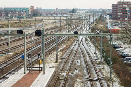breda: Overview of train tracks near the railway station of the Dutch city of Breda. Its a cold winter day. Stock Photo