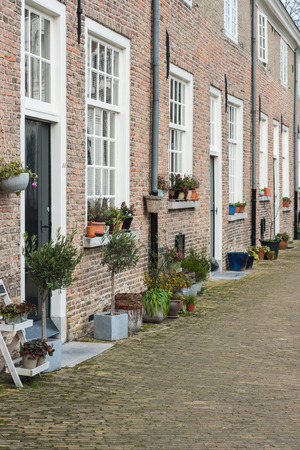 breda: Facades of small houses in an historic beguinage in the Dutch city of Breda in the winter season. The beguinage was built in 1535.