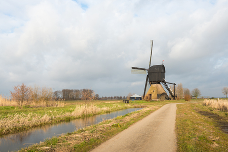 end mill: Large wooden hollow post mill in the Netherlands at the end of the winter season. The mill, a national monument, was originally built in 1795 and later partly burnt down and completely restored.