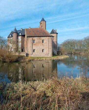 dutch: Historic Dutch castle with moat.