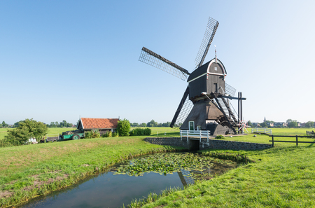 polder: Back side of a polder mill in the Dutch village of Streefkerk, which was built before the year 1751; now no longer in use as such but still capable to grind.