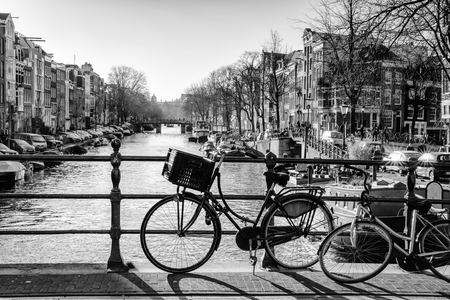 prinsengracht: Monochrome backlit image overlooking the Prinsengracht from bridge 64 (Reesluis). It is early in the morning on a sunny day in the winter season.