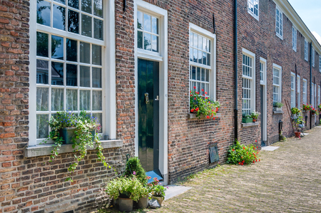 breda: Facades of the restored 16th-century houses in the Beguinage in the center of Breda on a beautiful summer day. This beguinage is the oldest Dutch beguinage. It was founded in the year 1267.
