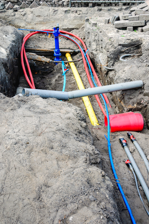 mains: Connecting colorful underground cables and mains at a housing project in the Netherlands.