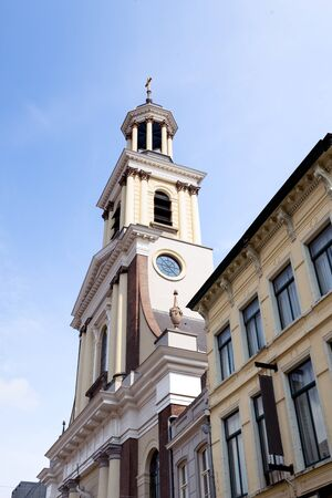 roman catholic: Closeup of the church tower of the St. Anthony Cathedral in Breda on a sunny summer day. The Roman Catholic church was built in 1837 and is now a national monument.