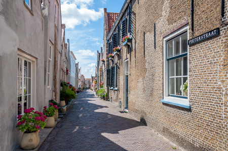 goeree: The picturesque Pieterstraat in the small Dutch town of Goedereede in the province of South Holland on a sunny day in the summer season.