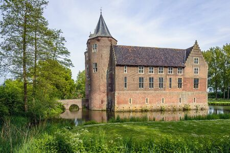subsequently: Dussen castle, here  in low sunlight, is situated in the municipality of Werkendam and in the Dutch province Noord-Brabant. The castle is originally built in 1393 and subsequently destroyed, rebuilt and restored.