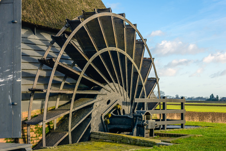 polder: Closeup of the paddle wheel of an old hollow post mill  in a Dutch polder. The mill was built in 1700.