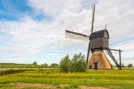 The Noordeveldse molen near the Dutch village of Dussen in North Brabant is a thatched stone hollow post mill with wooden upper house originally built in 1795. The photo of this national monument was taken on a beautiful day in the spring season. Lizenzfreie Bilder