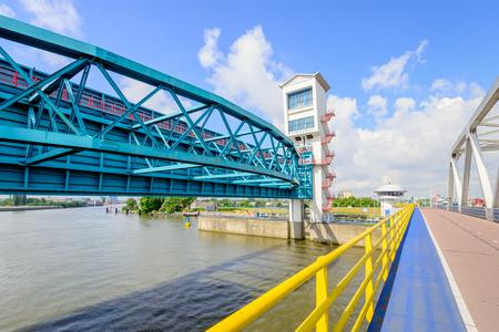 The Algera storm surge barrier is a hydraulic engineering work in the very large Dutch Delta Works project.  The barrier is situated in the Dutch river Hollandse IJssel at Krimpen aan den IJssel near Rotterdam. Stock Photo