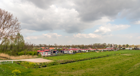 Colorful holiday bungalows in the Dutch village of Hank, North Brabant Stockfoto