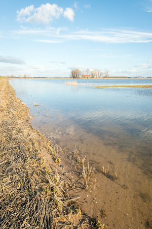 Partially flooded Noordwaard polder in Dutch National Park De Biesbosch. The polder has recently been redesigned as water storage at very high water in the adjacent river.
