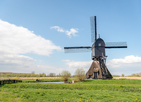 The Noordeveldse windmill in the Dutch village of Dussen, North Brabant is a wooden hollow post mill built in 1795.