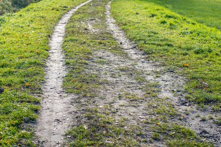 Wheel tracks on a muddy country road. It is fall in the Netherlands. 写真素材