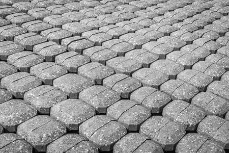 Monochrome image of the pavement of the foot of a dike on the side of an inlet in the Dutch province of Zeeland. Standard-Bild