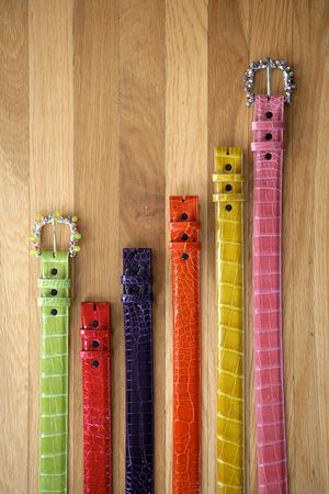 tooled: Aligator skin belts six in a row very colorful Stock Photo